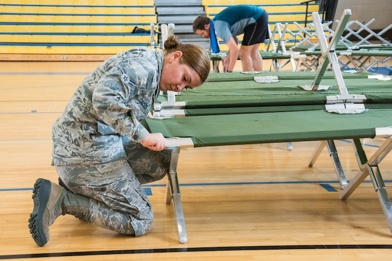 Personnel set up cots for evacuees from Hurricane Michael recently at Maxwell Air Force Base, Ala. (U.S. Air Force photo by William Birchfield)
