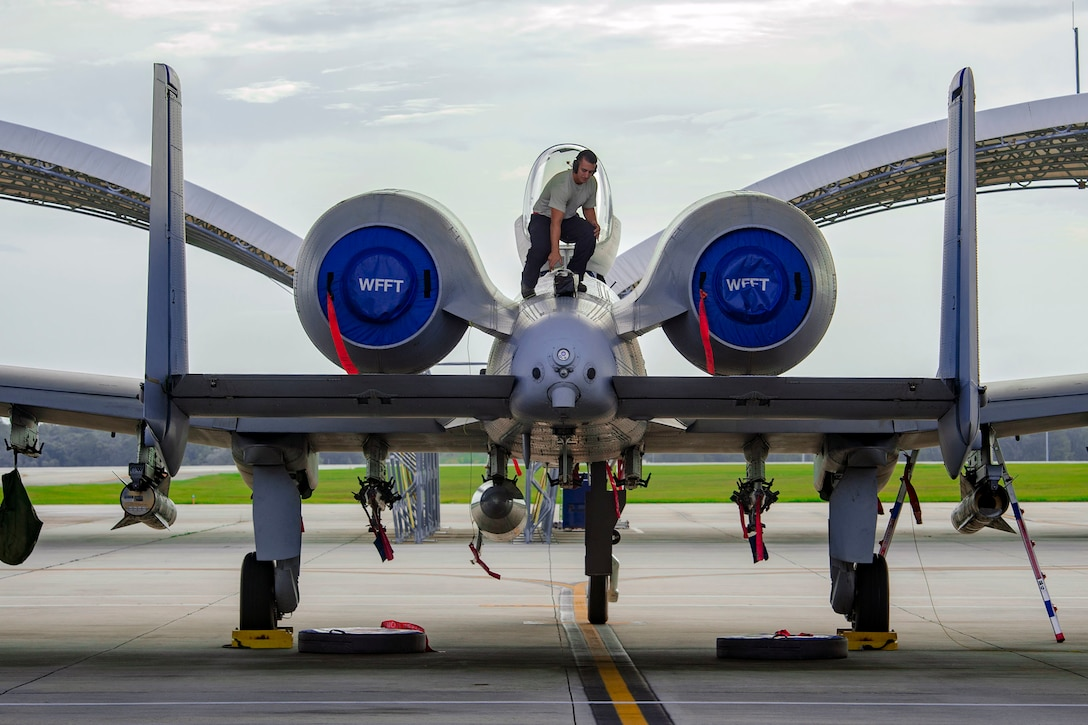 A 23rd Maintenance Group A-10C Thunderbolt II crew chief prepares an aircraft for relocation in anticipation of Hurricane Michael, Oct. 9, 2018, at Moody Air Force Base, Ga. To safeguard flying assets, Moody AFB is repositioning some aircraft to avoid the predicted tropical storm-force winds in the Southeast region. (U.S. Air Force photo by Senior Airman Greg Nash)
