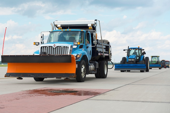 The 88th Civil Engineering Group heavy equipment and grounds crew, drive along the flightline during the annual snow truck and ice parade at Wright-Patterson Air Force Base, Ohio, October 3, 2018.