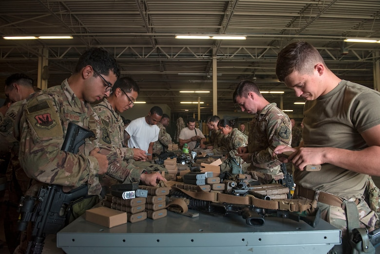 Defenders from the 822d Base Defense Squadron load ammunition prior to departing Moody Air Force Base, Ga., to provide base security at Tyndall AFB, Fla., during Hurricane Michael recovery efforts, Oct. 11, 2018. Moody's 'Safeside' defenders will secure the area as Tyndall's Ride Out Element conducts damage assessments during the aftermath. Since Oct. 8 and until further notice, Tyndall has been on evacuation notice. (U.S. Air Force photo by Senior Airman Greg Nash)
