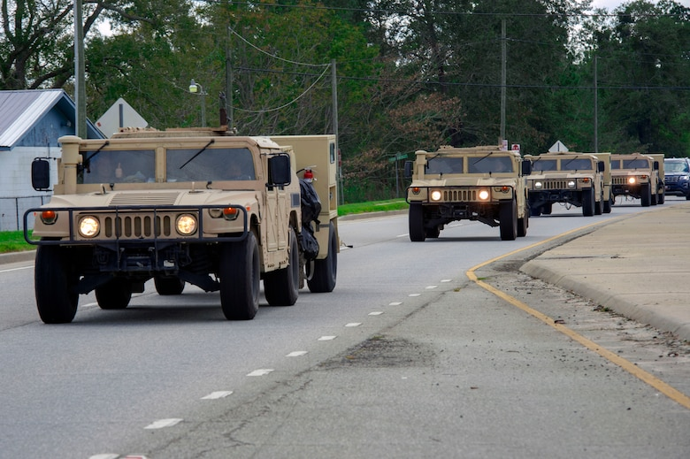 Airmen from the 822d Base Defense Squadron depart Moody Air Force Base, Ga., as they convoy en route to Tyndall AFB, Fla., to provide base security during Hurricane Michael recovery efforts, Oct. 11, 2018. Moody's 'Safeside' defenders will secure the area as Tyndall's Ride Out Element conducts damage assessments during the aftermath. Since Oct. 8 and until further notice, Tyndall has been on evacuation notice. (U.S. Air Force photo by Senior Airman Greg Nash)