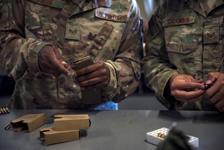 Defenders from the 822d Base Defense Squadron load ammunition into magazines prior to departing Moody Air Force Base, Ga., to provide base security at Tyndall AFB, Fla., during Hurricane Michael recovery efforts, Oct. 11, 2018. Moody's 'Safeside' defenders will secure the area as Tyndall's Ride Out Element conducts damage assessments during the aftermath. Since Oct. 8 and until further notice, Tyndall has been on evacuation notice. (U.S. Air Force photo by Senior Airman Greg Nash)