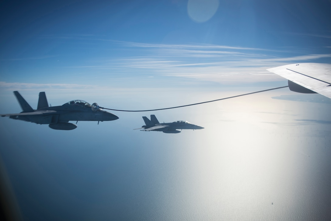 U.S. Navy F/A-18 Super Hornets assigned to the Carrier Air Wing from the USS Harry S. Truman (CVN-75), receive fuel from a U.S. Air Force KC-135 Stratotanker from RAF Mildenhall, during a large forces exercise off the coast of England, Oct. 11, 2018. RAF Lakenheath hosted a large force exercise that demonstrated U.S. ability to deter current and potential threats. (U.S. Air Force photo by Tech. Sgt. Emerson Nuñez)