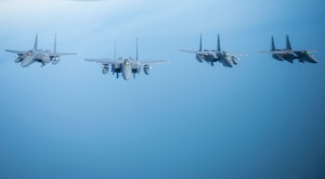 U.S. Air Force F-15E Strike Eagles assigned to RAF Lakenheath, England assemble in formation off the coast of England, Oct. 11, 2018. RAF Lakenheath hosted a large forces exercise that included F-22 Raptors from Joint Base Langley-Eustis, Va., F-15E Strike Eagles from RAF Lakenheath and F/A-18 Super Hornets from the Carrier Air Wing from USS Harry S. Truman (CVN-75). (U.S. Air Force photo by Tech. Sgt. Emerson Nuñez)