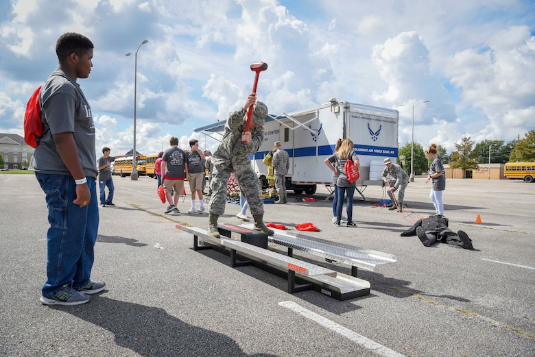 Senior Airman Dylan Brown, Columbus Air Force Base Fire Department driver and operator, demonstrates a hammer swing on a Keiser FORCE Machine Oct. 2, 2018, during the Imagine the Possibilities Career Expo at the BancorpSouth Arena in Tupelo, Mississippi. More than 120 Airmen from Columbus AFB, Mississippi, spent several days showing more than 7,000 eighth-grade students, from northeast Mississippi counties, some of the vast career opportunities the Air Force offers. (U.S. Air Force photo by Tech. Sgt. Christopher Gross)