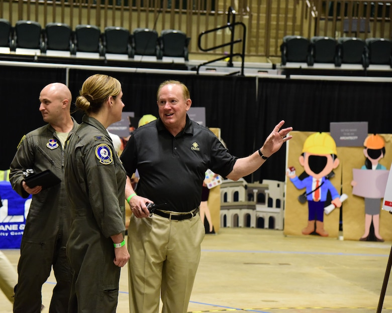 Col. Samantha Weeks, 14th Flying Training Wing commander, and Maj. Thomas Hyde, 14th Flying Training Wing commanders action group, tours the Imagine the Possibilities Career Expo with Mike Clayborne, president of the CREATE Foundation Oct. 2, 2018, at the BancorpSouth Arena in Tupelo, Mississippi. The three-day expo was hosted by the CREATE Foundation and was sponsored by more than 130 businesses to inspire local eighth-grade students. (U.S. Air Force photo by Elizabeth Owens)