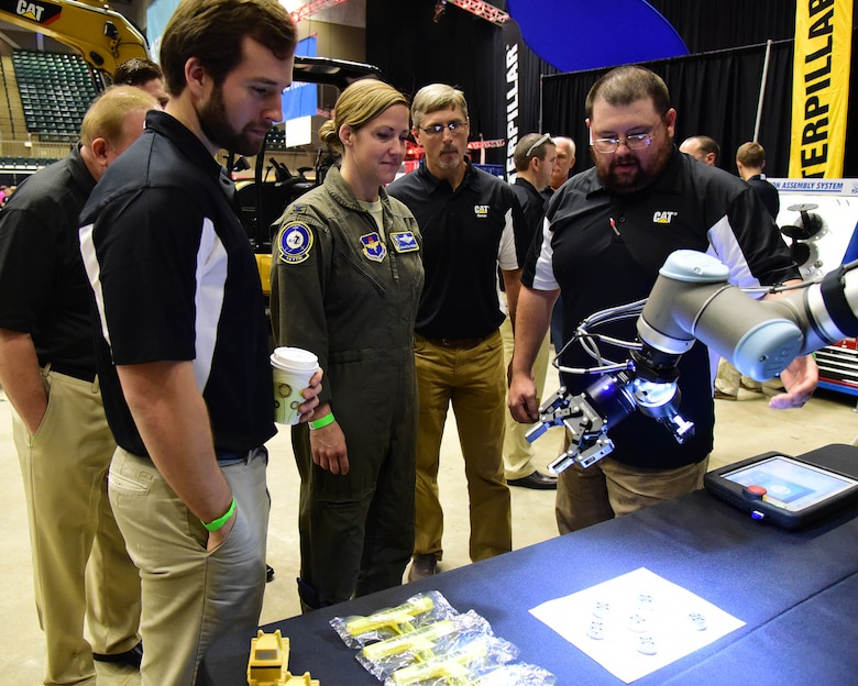 Col. Samantha Weeks, 14th Flying Training Wing commander, looks at a 3d printer duing the Imagine the Possibilities Career Expo, Oct. 2, 2018, at the BancorpSouth Arena in Tupelo, Mississippi. The three-day expo showcased hundreds of career opportunities and was sponsored by more than 130 businesses to inspire local eighth-grade students. (U.S. Air Force photo by Elizabeth Owens)