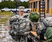 Members of Florida National Guard Chemical, Biological, Radiological and Nuclear Defense Enhanced Response Force Package prepare to help citizens in affected areas prior to landfall of Hurricane Michael at Camp Blanding Joint Training Center near Starke, Florida, Oct. 9, 2018.