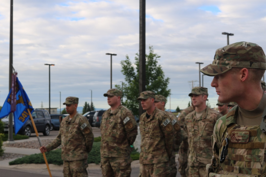 341st Security Forces Group defenders stand in formation for reveille June 23, 2017, at Malmstrom Air Force Base, Mont.