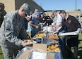 Members of the 552nd Air Control Wing lined up to fill their plates with shrimp, corn, potatoes and sausage during the Wing's Freedom Fest Sept. 27.