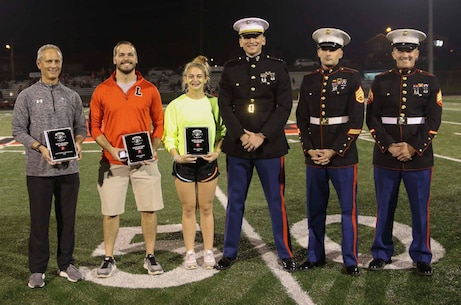 Marines with Recruiting Station Indianapolis presented an award to Logansport High School senior Mia Loposser on Oct. 5, in Indianapolis for being one of 96 in the nation and two in the state of Indiana to be selected to attend the Marine Corps Battles Won Academy. Loposser attended the Marine Corps event in July. (U.S. Marine Corps photo by Sgt. Carl King )
