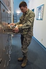 A 12th Training Squadron detail Airman, sorts through the Order of Daedalion's flight records April 18, 2018 at the Daedalian Foundation National Headquarters building on Joint Base San Antonio-Randolph, Texas. The Order of Daedalians has a record of every military flight conducted by its members organized and on file for those interested to look through. (U.S. Air Force photo by Airman Shelby Pruitt)