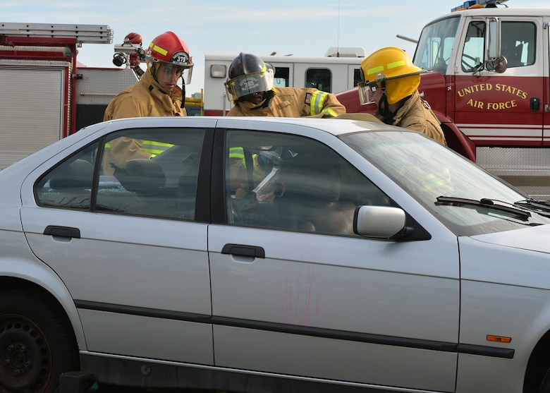 Firefighters from the 86th Civil Engineer Squadron perform an extrication exercise during an open house on Ramstein Air Base, Germany, Oct. 6, 2018. During Fire Prevention Week, members of the Kaiserslautern Military Community Fire and Emergency Services helped familiarize families with the importance of fire safety and how firefighters can help in emergency situations. (U.S. Air Force photo by Staff Sgt. Jimmie D. Pike)