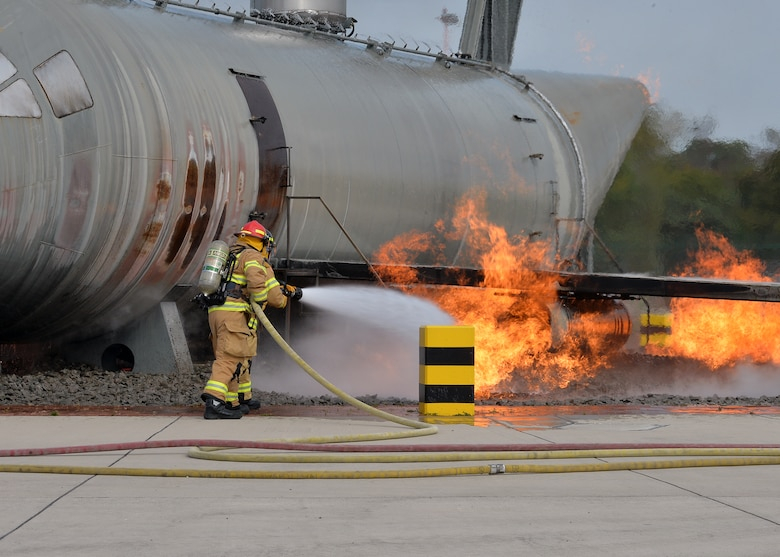 Firefighters assigned to the 86th Civil Engineer Squadron fight a simulated aircraft fire on Ramstein Air Base, Germany, Oct. 6, 2018. As part of the fire department's open house to kick off Fire Prevention Week, the firefighters demonstrated their skill for members of the Kaiserslautern Military Community. (U.S. Air Force photo by Staff Sgt. Jimmie D. Pike)