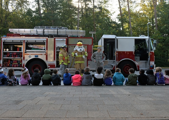 "U.S. Air Force Senior Airman Dakota Ball, 86th Civil Engineer Squadron driver operator, speaks to children during a Fire Prevention Week school visit on Ramstein Air Base, Germany, Oct. 9, 2018. This year's theme for Fire Prevention Week is, ""Look, Listen, Learn. Be aware. Fire can happen anywhere."" ""Look for places where a fire can happen, listen for smoke alarms, and learn two ways out of every room,"" said Jason Haddock, 86th CES Fire Prevention assistance fire chief. (U.S. Air Force photo by Staff Sgt. Jimmie D. Pike)"
