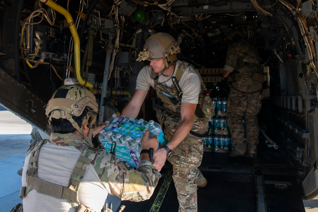 U.S. Air Force Special Tactics Airmen with the 23rd Special Tactics Squadron load water onto a CV-22 Osprey tiltrotor aircraft assigned to the 8th Special Operations Squadron at Hurlburt Field, Florida, Oct. 11, 2018.