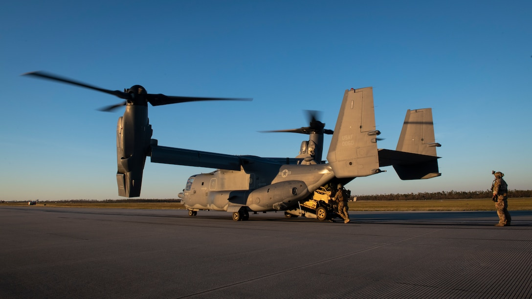U.S. Air Force Special Tactics Airmen with the 23rd Special Tactics Squadron unload an all-terrain vehicle from a CV-22 Osprey tiltrotor aircraft assigned to the 8th Special Operations Squadron at Tyndall Air Force Base, Florida, Oct. 11, 2018.
