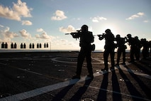 """Marines with Battalion Landing Team, 1st Battalion, 2nd Marines, 22nd Marine Expeditionary Unit, conduct a life-fire """"deck shoot"""" to enhance their combat effectiveness and readiness aboard the flight deck of the USS Arlington during Amphibious Ready Group/MEU Exercise in the Atlantic Ocean, Sept. 2, 2018. This training exercise enhances joint integration, lethality, and the collective capabilities of the Navy-Marine Corps team through joint planning and execution of challenging and realistic training scenarios in preparation for their upcoming deployment."""