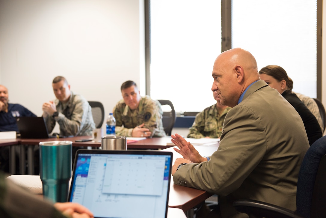 Dr. Melvin Deaile teaches a class of students enrolled in The School of Advanced Nuclear Deterrence Studies at Air Command and Staff College, September 19, 2018. Students are immersed in deterrence theory as well as the technical and strategic aspect of nuclear operations. Deaile, a 2017 Air Education and Training Command educator of the year, is the director of SANDS, which recently moved from Kirtland Air Force Base, New Mexico, to Air University.  (U.S. Air Force photo by Airman First Class Charles Welty)