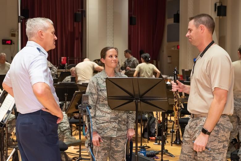 Tour soloist Senior Master Sgt. Blake Arrington confers with Col. Lang and 1st Lt. Christina Muncey