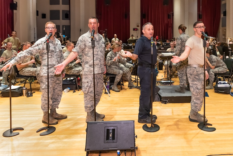 Male vocalists from the Singing Sergeants rehearse with the Concert Band in preparation for the 2018 Fall tour