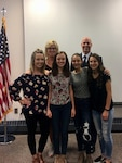 Col. Gary McCue (back right) and wife Molly stand behind their daughters Emily (from left), Josie, Zoe and Carly after Josie took the oath of enlistment May 9, 2018, to become a member of the Ohio Air National Guard. Josie, a 17-year-old high school senior at Clear Fork High School in Richland County, decided to enlist as a crew chief with the 179th Airlift Wing, the same military job and unit where her father started his career in 1983.