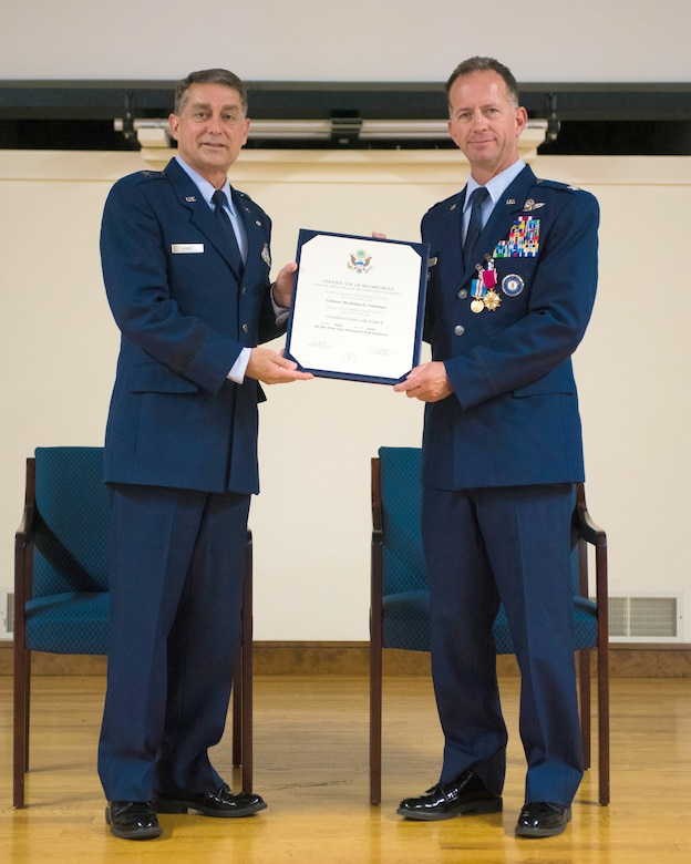 Brig. Gen. Warren Hurst (left), Kentucky's assistant adjutant general for Air, presents the certificate of retirement to Col. Nicholas Coleman during Coleman's retirement ceremony at the Kentucky Air National Guard Base in Louisville, Ky., Sept. 15, 2018. Coleman's career spanned more than 30 years in both the active-duty Air Force and Kentucky Air National Guard. (U.S. Air National Guard photo by Master Sgt. Vicky Spesard)