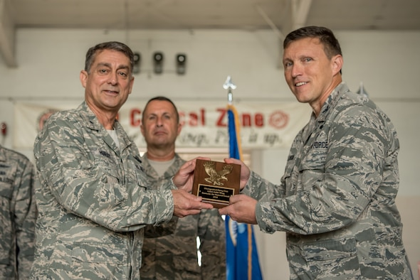 Col. Jeffrey Wilkinson (right), commander of the 123rd Airlift Wing, receives the 2018 Distinguished Flying Unit Plaque from Brig. Gen. Warren Hurst, Kentucky's assistant adjutant general for Air, during a ceremony at the Kentucky Air National Guard Base in Louisville, Ky., Sept. 16, 2018. The plaque, bestowed annually to the five highest-rated Air National Guard units in the nation, highlights the wing's performance in operations, human resources, accident prevention and community engagement during the period from Jan. 1 to Dec. 31, 2017. (U.S. Air National Guard photo by Staff Sgt. Joshua Horton)