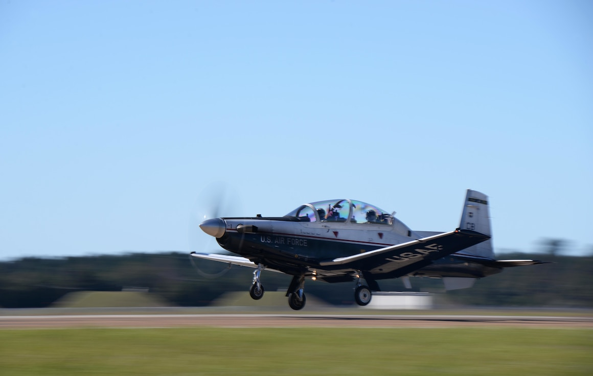 """Columbus Air Force Base is home of the 14th Flying Training Wing of Air Education and Training Command's 19th Air Force. The 14th FTW mission statement is """"Produce Pilots, Advance Airmen, Feed the Fight."""" The wing's mission is specialized undergraduate pilot training in the T-6 Texan II, T-38C Talon and T-1A Jayhawk aircraft. Each day the wing flies an average of 260 sorties on its three parallel runways. In addition to the flying training mission, Columbus AFB maintains more than 900 highly trained individuals capable of deploying at a moment's notice to support worldwide taskings and contingencies."""