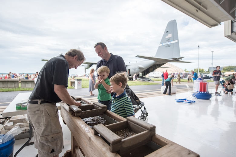 Lt. Col. Jason Schmidt (right), a pilot assigned to the 165th Airlift Squadron, and his sons participate in a rock-sifting demonstration during Family Day at the Kentucky Air National Guard Base in Louisville, Ky., Sept. 16, 2018. The event, which was sponsored by the Airman and Family Readiness Office and the Key Volunteer Group, featured a car show, a static-display C-130 Hercules aircraft and several other activities. (U.S. Air National Guard photo by Master Sgt. Phil Speck)