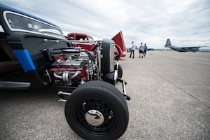 Vintage cars sit on the 123rd Airlift Wing flight line during Family Day at the Kentucky Air National Guard Base in Louisville, Ky., on Sept. 16, 2018. The event, which was sponsored by the Airman and Family Readiness Office and the Key Volunteer Group, also featured a static-display C-130 Hercules aircraft and several other activities. (U.S. Air National Guard photo by Master Sgt. Phil Speck)