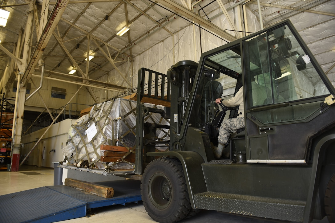 Staff Sgt. Rey Solis, 92nd Logistics Readiness Squadron vehicle maintenance, operates a forklift carrying cargo to be loaded onto a KC-135 Stratotanker at Fairchild Air Force Base, Washington, Sept. 21, 2018. LRS Airmen have a variety of mission sets including vehicle maitnenance, individual protection equipment, air transportation operations and more, which are essential to mission success. (U.S. Air Force phot/Airman 1st Class Lawrence Sena)