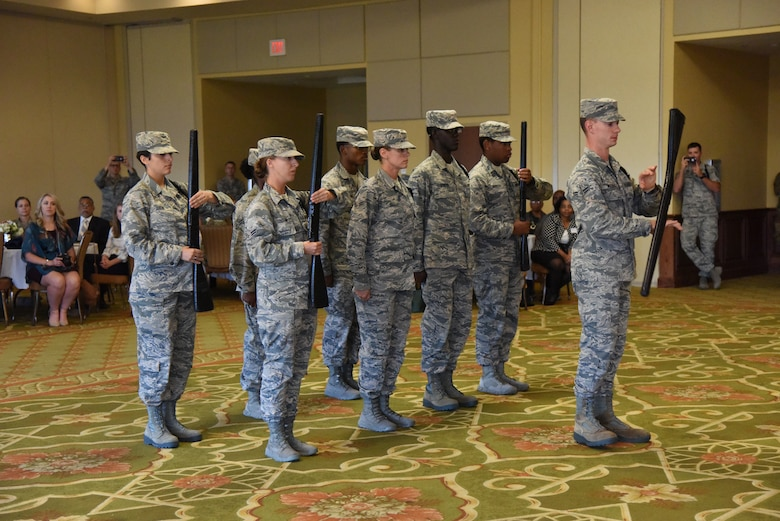 Members of the 335th Training Squadron drill team perform during the Biloxi Chamber Morning Call in the Bay Breeze Event Center at Keesler Air Force Base, Mississippi, Oct. 11, 2018. Local business and community leaders attended the event, hosted by the 81st Training Wing, to learn more about the base's mission and its Airmen. (U.S. Air Force photo by Kemberly Groue)