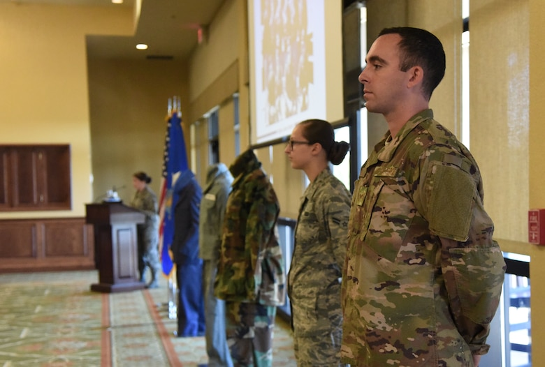 U.S. Air Force Senior Airman Travis Beihl and Airman 1st Class Suzanna Plotnikov, 81st Training Wing photojournalists, participate in a historical presentation during the Biloxi Chamber Morning Call in the Bay Breeze Event Center at Keesler Air Force Base, Mississippi, Oct. 11, 2018. Local business and community leaders attended the event, hosted by the 81st TRW, to learn more about the base's mission and its Airmen. (U.S. Air Force photo by Kemberly Groue)