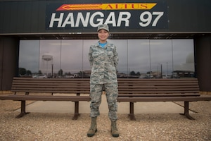 U.S. Air Force Airman 1st Class Michelle Vi Torculas, a food services specialist assigned to the 97th Force Support Squadron, stands outside the Hangar 97 Dining Facility where she works, Oct. 12, 2018, at Altus Air Force Base, Okla. Torculas won the region two 2018 Arthur J. Myers Food Service Excellence Award for her hard work in her career field. (U.S. Air Force photo by Senior Airman Cody Dowell)