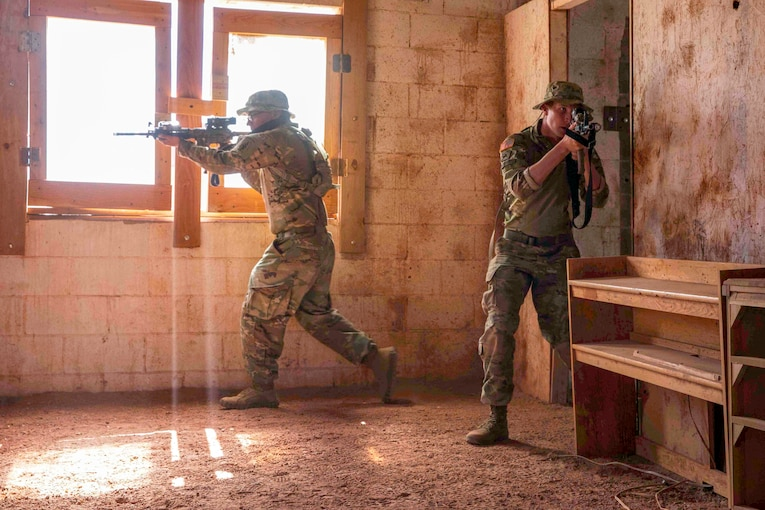 Army Special Forces paratroopers enter a building during close quarters battle training