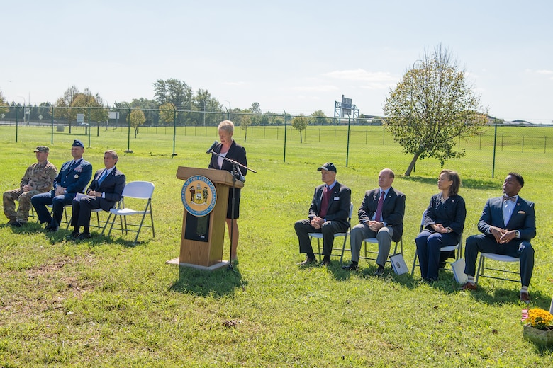 Jennifer Cohan, Secretary of the Delaware Department of Transportation, gives opening remarks during the Senior Airman Elizabeth Loncki bridge dedication ceremony Oct. 12, 2018, at Dover Air Force Base, Del.