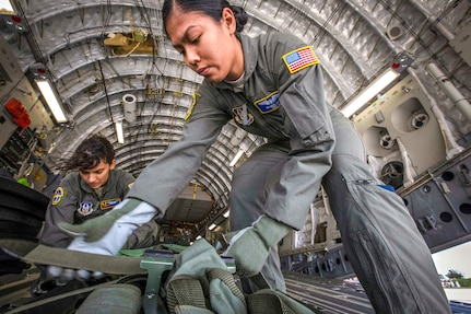 Staff Sgt. Belinda S. Son, right, 514th Aeromedical Evacuation Squadron aeromedU.S. Air Force Staff Sgt. Belinda S. Son (right), 514th Aeromedical Evacuation Squadron aeromedical evacuation technician, and Senior Airman Stephanie Lezcano, 45th AES aeromedical evacuation technician, strap down equipment on a C-17 Globemaster III prior to a joint training mission at Joint Base McGuire-Dix-Lakehurst, New Jersey, Oct. 5, 2018. (U.S. Air Force photo by Master Sgt. Mark C. Olsen)ical evacuation technician, and Senior Airman Stephanie Lezcano, 45th AES aeromedical evacuation technician, strap down equipment prior to a joint training mission with the 514th AES, 45th AES and the 439th AES at Joint Base McGuire-Dix-Lakehurst, N.J., Oct. 5, 2018. (U.S. Air Force photo by Master Sgt. Mark C. Olsen)