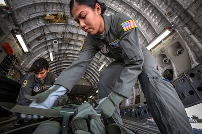 U.S. Air Force Staff Sgt. Belinda S. Son, right, an aeromedical evacuation technician with the 514th Aeromedical Evacuation Squadron (AES), 514th Air Mobility Wing, and Senior Airman Stephanie Lezcano, an aeromedical evacuation technician with the 45th AES, strap down equipment prior to a joint training mission with the 514th AES, 45th AES, and the 439th AES at Joint Base McGuire-Dix-Lakehurst, N.J., Oct. 5, 2018. The 514th is an Air Force Reserve Command unit. The 45th and the 439th AES are Air Force Reserve Command units from MacDill Air Force Base, Fla., and Westover Air Reserve Base, Mass. (U.S. Air Force photo by Master Sgt. Mark C. Olsen)