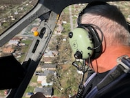 Bay County Sheriff's Office Chief Pilot Larry Kennedy overlooks the damage caused by Hurricane Michael while conducting air surveillance with the Florida National Guard. Kennedy was accompanied by Guard members to assess the damage and to find the places that need the most support.