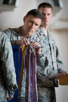 Col. Jeff Wilkinson, commander of the 123rd Airlift Wing, pins a steamer to the unit colors during a ceremony at the Kentucky Air National Guard Base in Louisville, Ky., Sept. 16, 2018. The streamer signifies the unit's selection for its 17th Air Force Outstanding Unit Award, continuing the wing's legacy as one of the most decorated organizations in U.S. Air Force History. (U.S. Air National Guard photo by Lt. Col. Dale Greer)