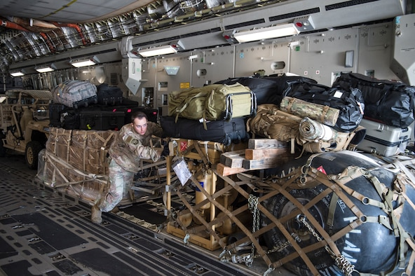 Senior Airman Clinton Andrews, 821st Contingency Response Support Squadron aerial porter, offloads cargo from a Travis Air Force Base C-17 Globemaster III at Tyndall Air Force Base, Florida, Oct. 12, 2018. The contingency response team deployed to assess damage and establish conditions for the re-initiation of airflow, bringing much needed equipment, supplies and personnel for the rebuilding of the base in the aftermath of Hurricane Michael. AMC equipment and personnel stand by across the nation to provide even more support upon request (U.S. Air Force photo by Tech. Sgt. Liliana Moreno)