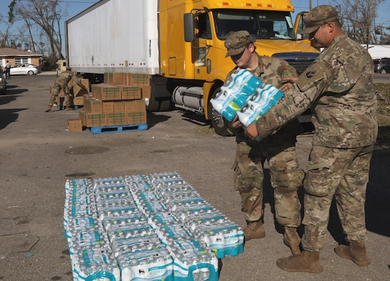 Florida National Guard Soldiers from the 53rd Infantry Brigade Combat Team, 2-124 Charlie Co., Ocala, Fla., stack water at the Rosenwald High School point of distribution to give to local citizens during Hurricane Michael disaster relief, Panama City, Fla., Oct. 13, 2018.