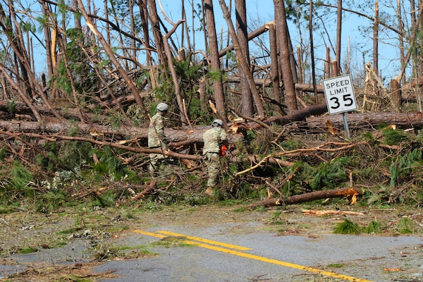 Florida National Guard members of the 753rd Brigade Engineer Battalion from Tallahassee, Florida, work on clearing the roads following the destruction of Hurricane Michael, Oct. 13, 2018, in Panama City, Florida.