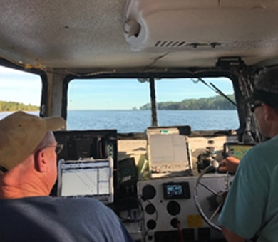 Irvington Site Office survey crew members survey the Gulf Intracoastal Waterway in the aftermath of Hurricane Michael.