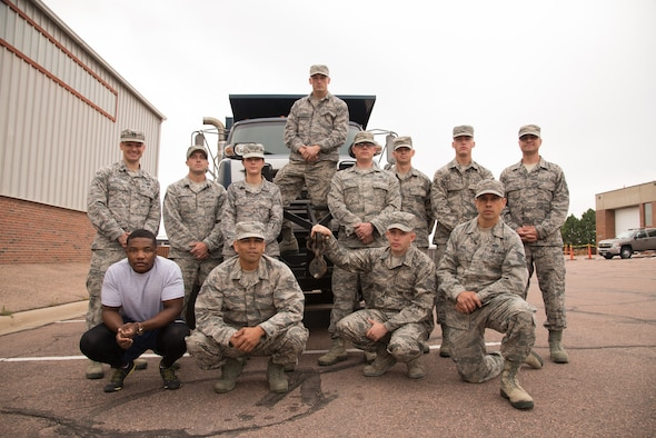 Reserve Citizen Airmen from the 302nd Civil Engineer Squadron who recently returned from a deployment in Southwest Asia pose for a group photo in front of heavy equipment at Peterson Air Force Base, Colorado, Sept. 9, 2018. During their deployment, 302nd CES reservists earned six individual and eight group awards. (U.S. Air Force photo by Staff Sgt. Justin R. Norton)