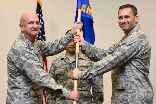 Maj. Kelly Soich (right) takes the 403rd Aircraft Maintenance Squadron guidon from Col. Jay Johnson, 403rd Maintenance Group commander, during a change of command ceremony held Oct. 14, 2018, at the Roberts Consolidated Aircraft Maintenance Facility, Keesler Air Force Base, Mississippi. Soich took command of the 403rd AMXS after the previous commander, Maj. Adam Zeithammel, had been selected to fill a position with Air Force Special Operations Command. (U.S. Air Force photo by Tech. Sgt. Ryan Labadens)