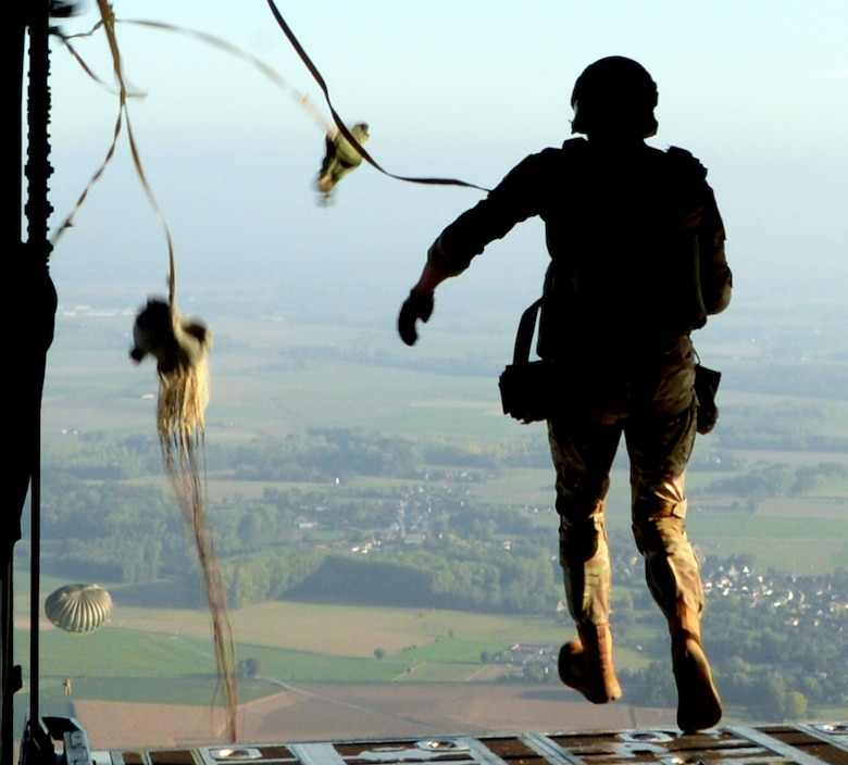 A parajumper airdrops from a C-130J Super Hercules aircraft over Chievres Air Base, Belgium, Oct. 4, 2018. Twelve parapjumpers participated in the jump on Chievres as a co-operablity exercise between Airmen from Chievers and Ramstein Air Base to show the base's ability to extend air power to Belgium. (U.S Air Force photo by Airman 1st Class Ariel Leighty)