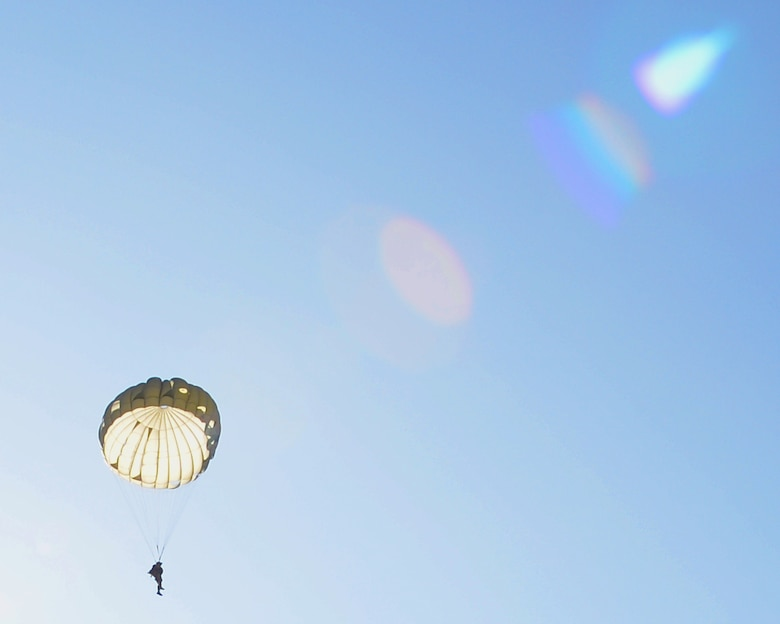 A parajumper descends from a C-130J Super Hercules aircraft over Chievres Air Base, Belgium, Oct. 4, 2018. Twelve parapjumpers participated in the jump on Chievres as a co-operablity exercise between Airmen from Chievers and Ramstein Air Base to show the base's ability to extend air power to Belgium. (U.S Air Force photo by Airman 1st Class Ariel Leighty)
