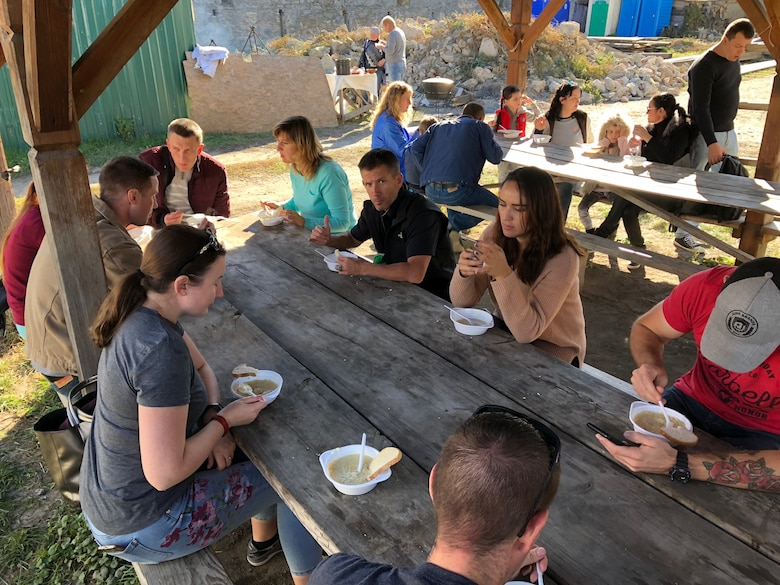 U.S. and Ukrainian airmen visited the Medzhybiz Fortress in Ukraine as part of cultural day activities on Oct. 14, 2018, which included sampling traditional Ukrainian cuisine. (U.S. Air Force photo by Maj. Tristan Hinderliter)